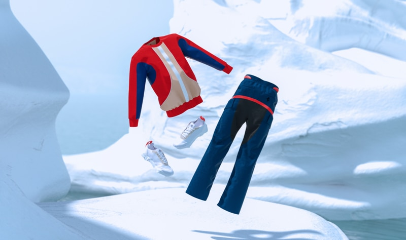 Red, gray and blue sweatshirt and blue cargo trousers with red line floating over a snow background