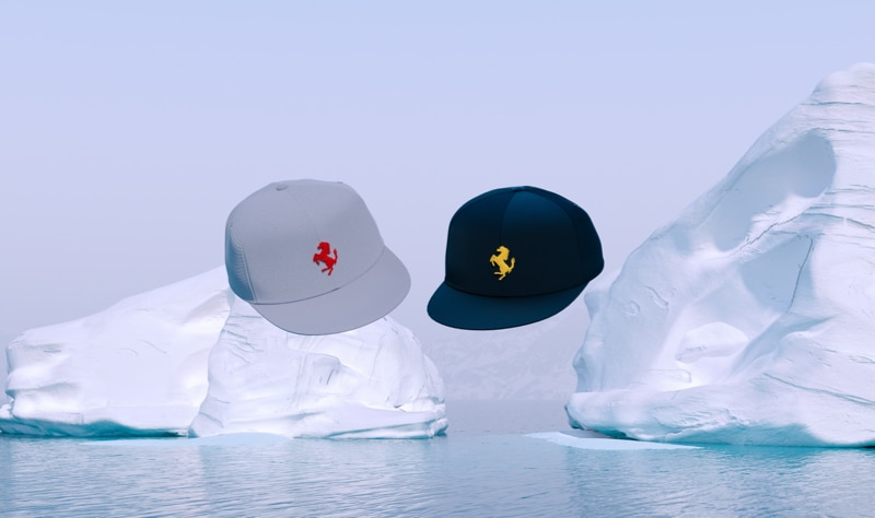 Gray and dark blue baseball hats with Prancing Horse logo floating over icebergs