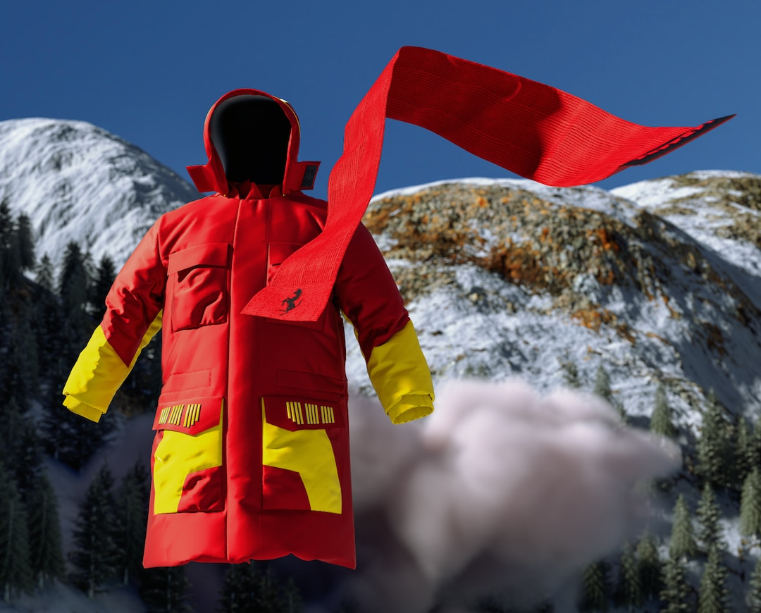 Red scarf with black Prancing Horse logo and red parka with yellow pockets and sleeves against a mountain backdrop