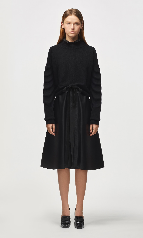 Model is wearing a Ferrari black dress and jumper